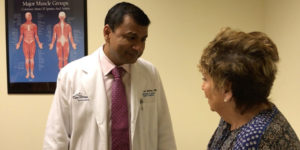 dr mathur talking to a patient